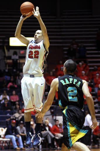 Mississippi's Marshall Henderson (22) shoots a 3-pointer against Coastal Carolina's Anthony Raffa (2) during their NCAA college basketball game, Tuesday, Nov. 13, 2012, in Oxford, Miss. Mississippi won 90-72. (AP Photo/The Oxford Eagle, Bruce Newman)