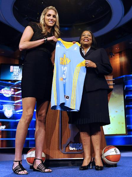 Delaware's Elena Delle Donne holds up a Chicago Sky jersey with WNBA president Laurel J. Richie after Chicago selected Delle Donne as the No. 2 pick in the WNBA basketball draft in Bristol, Conn., Monday, April 15, 2013. (AP Photo/Jessica Hill)