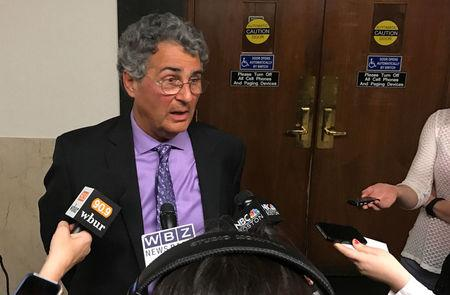 Retired Massachusetts physician Kligler, a plaintiff in a right-to-die lawsuit, speaks to reporters outside a courtroom in Suffolk County Superior Court in Boston