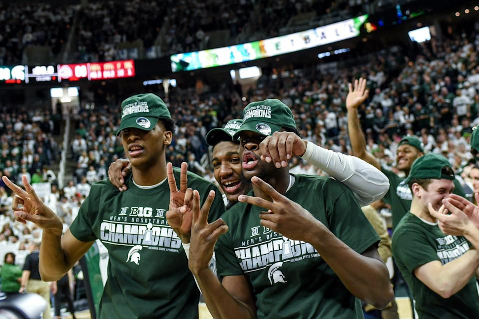 From left, Michigan State's Marcus Bingham Jr., Aaron Henry and Gabe Brown celebrate after beating Ohio State on Sunday, March 8, 2020, at the Breslin Center in East Lansing. The Spartans won a share of the Big Ten Championship.