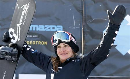 Canada's Maelle Ricker celebrates on the podium after the women's Snowboard-Cross finals at the FIS Snowboard World Championships in Stoneham, Quebec, January 26, 2013. REUTERS/Mathieu Belanger