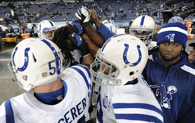 Indianapolis Colts players huddle before an NFL football game against the Tennessee Titans on Thursday, Nov. 14, 2013, in Nashville, Tenn. (AP Photo/Mark Zaleski)