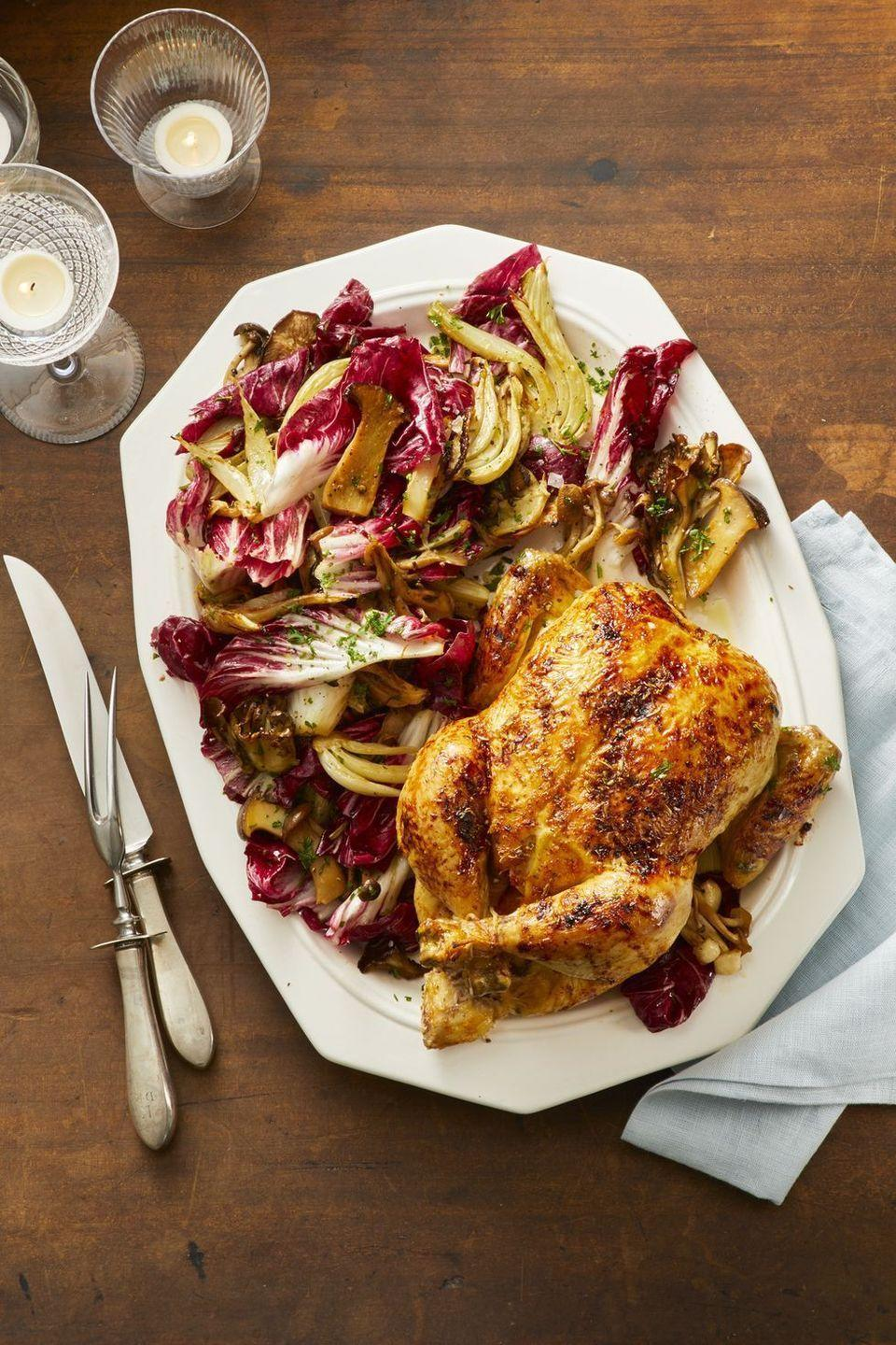 """<p>Roasting a whole chicken has never been so easy. The secret? Using this medley of fresh vegetables as a bed for all those delicious juices.</p><p><em><a href=""""https://www.goodhousekeeping.com/food-recipes/a25323997/orange-ginger-roast-chicken-with-fennel-and-radicchio-salad-recipe/"""" rel=""""nofollow noopener"""" target=""""_blank"""" data-ylk=""""slk:Get the recipe for Orange-Ginger Roast Chicken With Fennel and Radicchio Salad »"""" class=""""link rapid-noclick-resp"""">Get the recipe for Orange-Ginger Roast Chicken With Fennel and Radicchio Salad »</a></em><br></p>"""