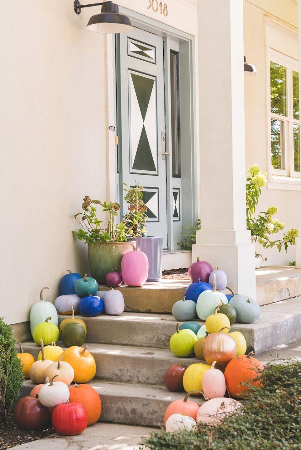 """<p>On the other end of the spectrum, if you love loads of color, this rainbow outdoor pumpkin display is one for the books. </p><p><strong>See more at <a href=""""https://thehousethatlarsbuilt.com/2020/08/diy-rainbow-pumpkins.html/"""" rel=""""nofollow noopener"""" target=""""_blank"""" data-ylk=""""slk:The House That Lars Built"""" class=""""link rapid-noclick-resp"""">The House That Lars Built</a>. </strong></p><p><a class=""""link rapid-noclick-resp"""" href=""""https://www.amazon.com/Krylon-K01020A07-Premium-Metallic-Brilliance/dp/B00448FUB8?tag=syn-yahoo-20&ascsubtag=%5Bartid%7C2164.g.36877187%5Bsrc%7Cyahoo-us"""" rel=""""nofollow noopener"""" target=""""_blank"""" data-ylk=""""slk:SHOP METALLIC SPRAY PAINT""""><strong>SHOP METALLIC SPRAY PAINT</strong></a></p>"""