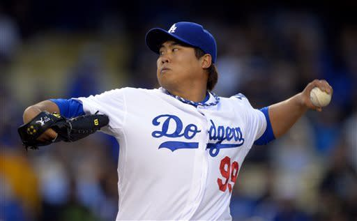 Los Angeles Dodgers starting pitcher Ryu Hyun-jin, of South Korea, throws to the plate during the first inning of their baseball game against the Colorado Rockies, Tuesday, April 30, 2013, in Los Angeles. (AP Photo/Mark J. Terrill)