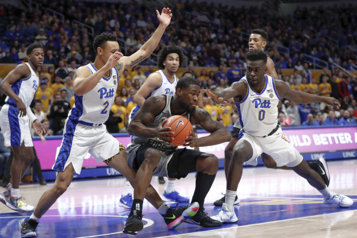 Wake Forest's Chaundee Brown. center, tries to control the ball as Pittsburgh's Eric Hamilton (0) and Trey McGowens (2) defend during the first half of an NCAA college basketball game, Saturday, Jan. 4, 2020, in Pittsburgh. (AP Photo/Keith Srakocic)