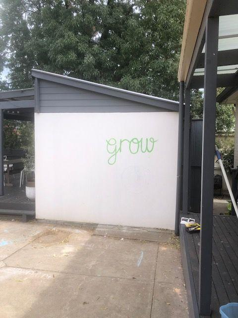 <p>Hayley McDonald's backyard wall would get filthy from her sons hitting, kicking, and throwing balls against it, so she came up with an idea to make it art. So she created the multi-colored geometric painted wall in one weekend.</p>