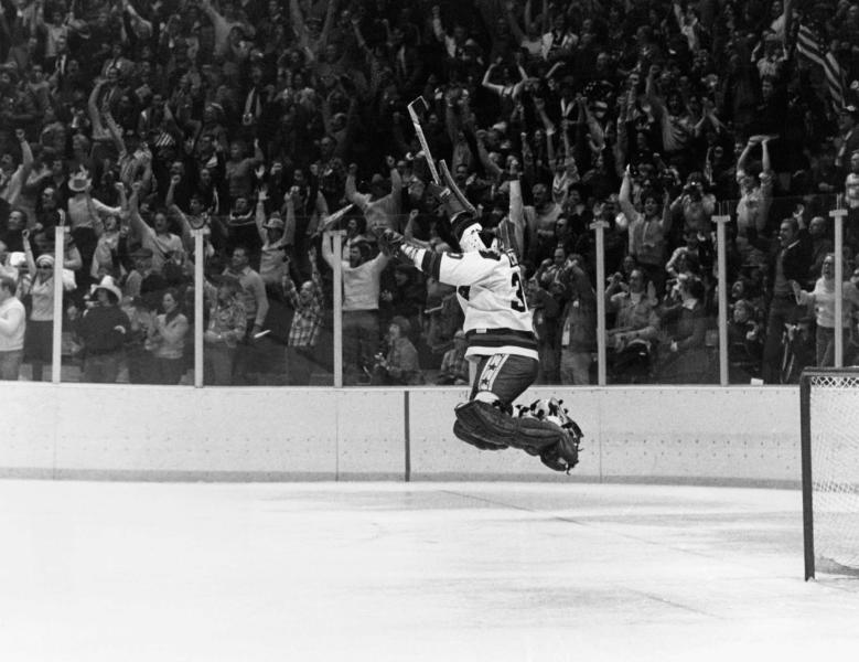 FILE - In this Feb. 22, 1980, file photo, U.S. goalie James Craig leaps high in the air in the final second of a 4-3 win over the Soviet Union in a medal match at the 1980 Winter Olympics in Lake Placid, N.Y.  (AP Photo/File)