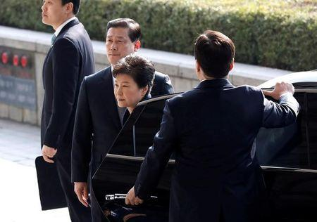 FILE PHOTO: South Korea's ousted leader Park Geun-hye arrives at a prosecutor's office in Seoul