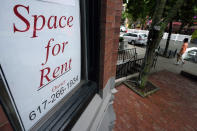 In this Sept. 2, 2020 photo, a passer-by walks past a business storefront with a space for rent sign in a window in Boston. Commercial real estate has been among the industries hardest hit by the pandemic, and there are doubts about how quickly it will recover. Vacancy rates for retail, office and other property types are up sharply from a year ago. (AP Photo/Steven Senne)
