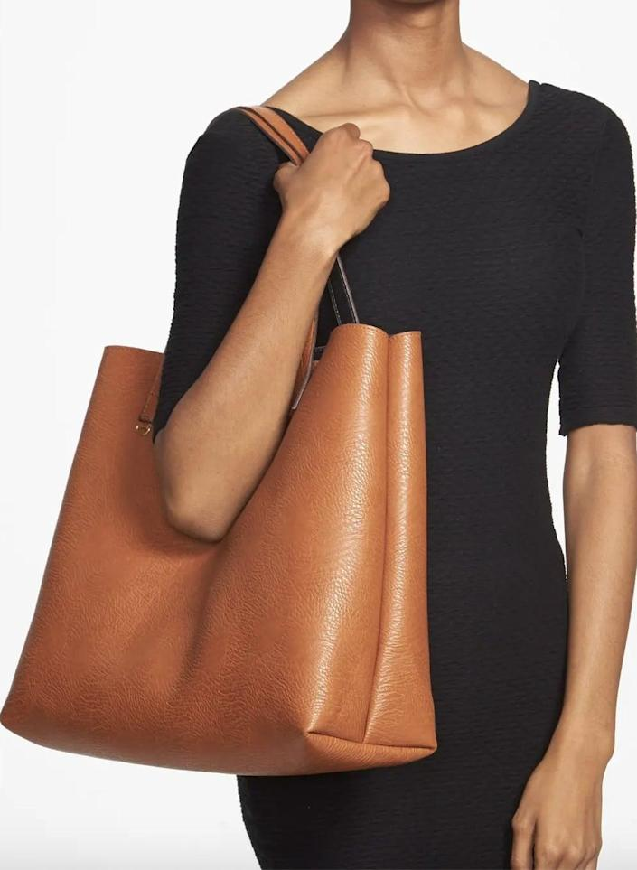 <p>We love that this <span>Street Level Faux Leather Tote &amp; Wristlet</span> ($49) is reversible, because you'll never tire of rocking it.</p>