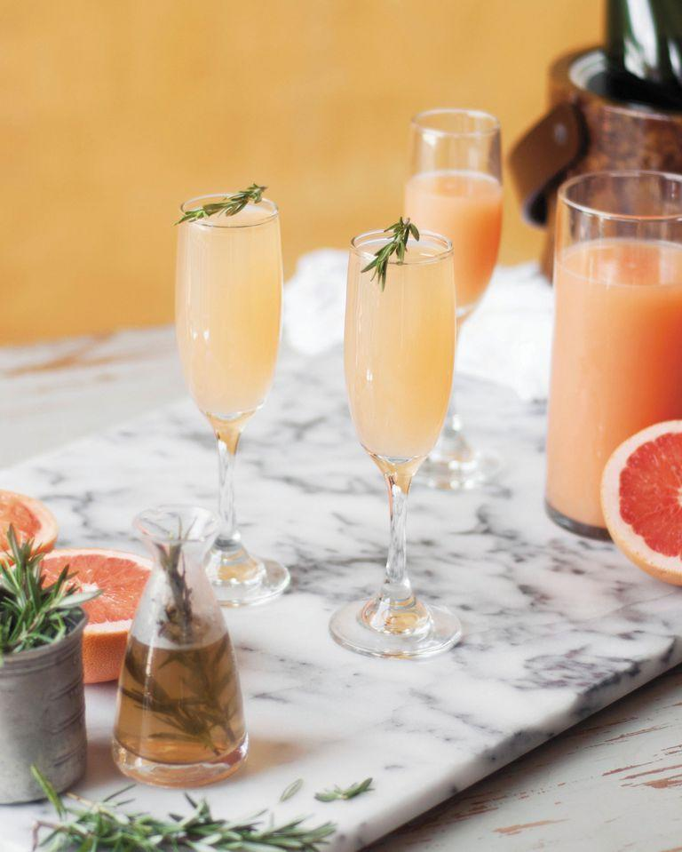 """<p>If the traditional mimosa is a bit too sweet, try this grapefruit version for a taste of elegance.</p><p><em><strong>Get the recipe at </strong><a href=""""https://www.countryliving.com/food-drinks/recipes/a42606/grapefruit-and-rosemary-mimosa/"""" rel=""""nofollow noopener"""" target=""""_blank"""" data-ylk=""""slk:Country Living."""" class=""""link rapid-noclick-resp""""><strong>Country Living</strong>. </a></em></p>"""