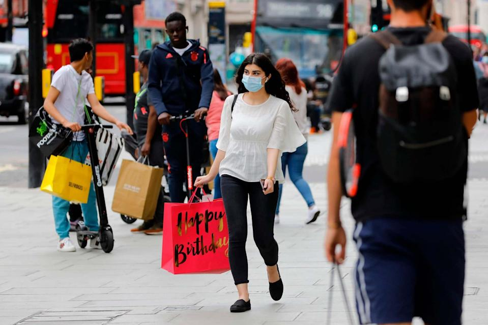 A shopper wears a face mask on Oxford Street (AFP via Getty Images)