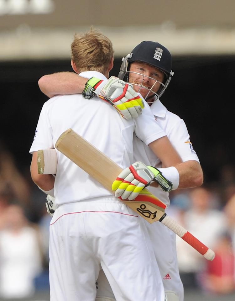 England's Joe Root (left) celebrates scoring 100 not out with Ian Bell on day three of the Second Investec Ashes Test at Lord's Cricket Ground, London.