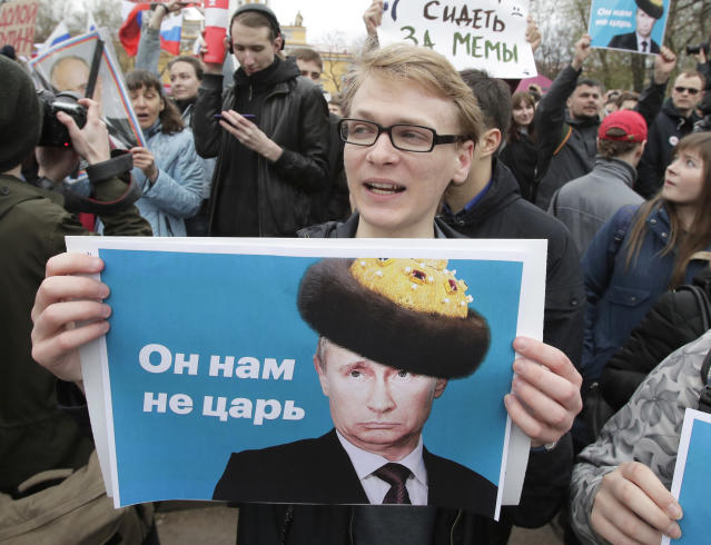 "<p>Demonstrators carry posters depicting Russian President Vladimir Putin during a massive protest rally in St.Petersburg, Russia, Saturday, May 5, 2018. Alexei Navalny, anti-corruption campaigner and Putin's most prominent critic, called for nationwide protests on Saturday, two days ahead of the inauguration of Vladimir Putin for a fourth term as Russian president. The sign on poster reading ""He is not our czar"". (Photo: Dmitri Lovetsky/AP) </p>"