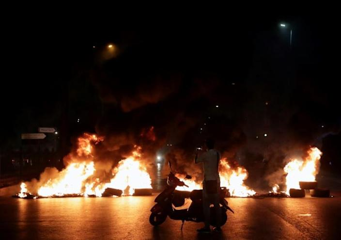 Protesters burned tyres as hundreds of people took to the streets in anger over a move to tax calls on messaging apps (AFP Photo/ANWAR AMRO)