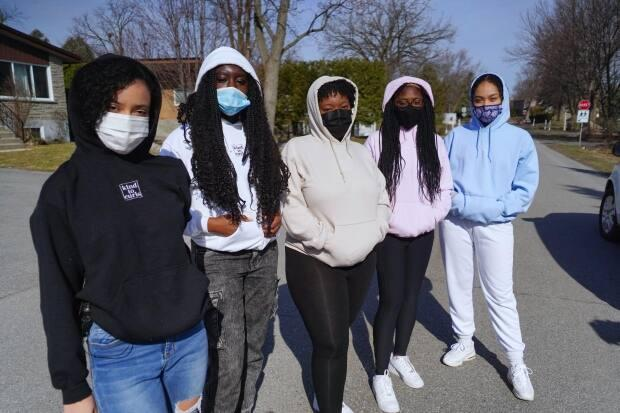 From left to right: Kelly Lacroix, Catherine Okeke, Tatiyana Frazer, Keisha Moore and Tarah Grant. (Charles Contant/CBC - image credit)