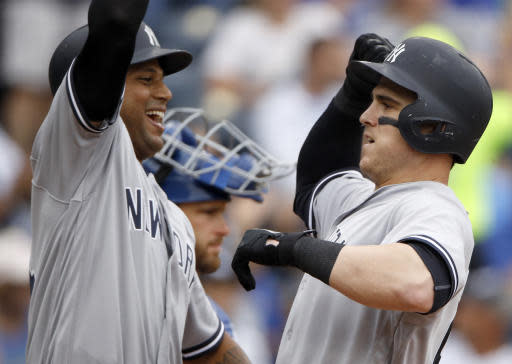 New York Yankees' Tyler Austin, right, celebrates with Aaron Hicks after hitting a two-run home run during the fifth inning of a baseball game against the Kansas City Royals, Sunday, May 20, 2018, in Kansas City, Mo. (AP Photo/Charlie Riedel)