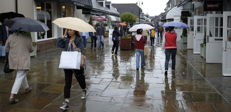 Shoppers at Bicester Village designer outlet centre, in Bicester, England