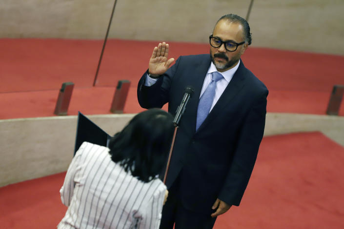 New Ideas party lawmaker Ernesto Castro is sworn-in as president of the El Salvador's Congress in San Salvador, El Salvador, Saturday, May 1, 2021. For the first time in three decades the traditional conservative and leftist parties have been sidelined by a resounding electoral defeat, clearing the way for President Nayib Bukele's party to help him advance his agenda. (AP Photo/Salvador Melendez)