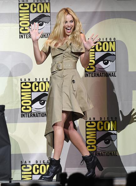 <p>Margot Robbie went for a fashion-forward look with a deconstructed trench coat dress from Monse with Louis Vuitton booties as she promoted <i>The Suicide Squad</i>. (<i>Photo: Getty Images)</i></p>