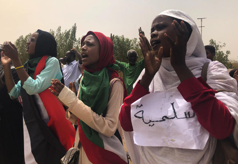 "FILE - In this June 30, 2019 file photo, Sudanese protesters chant slogans as they march during a demonstration against the ruling military council, in Khartoum, Sudan. The sign in Arabic reads, ""peace."" Sudan's uprising has ushered in a new era both for the nation and for Sudanese women after three decades of autocratic rule by Omar al-Bashir. Sudanese women played a pivotal role in the protests that brought down al-Bashir, and under a joint military-civilian council in power now, they hope for more freedom and equality, and seek to overturn many of the restrictive Islamic laws from the previous era. (AP Photo/Hussein Malla, File)"