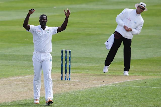 DUNEDIN, NEW ZEALAND - DECEMBER 03: Darren Sammy of the West Indies looks after being worked away for four runs during day one of the first test match between New Zealand and the West Indies at University Oval on December 3, 2013 in Dunedin, New Zealand. (Photo by Hannah Johnston/Getty Images)