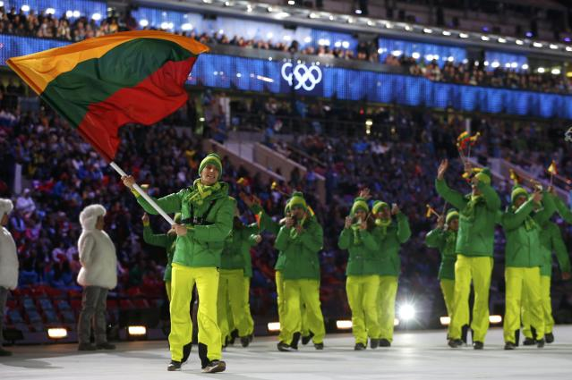 Lithuania's flag-bearer Deividas Stagniunas leads his country's contingent as they march in during the opening ceremony of the 2014 Sochi Winter Olympics, February 7, 2014. REUTERS/Jim Young (RUSSIA - Tags: OLYMPICS SPORT)