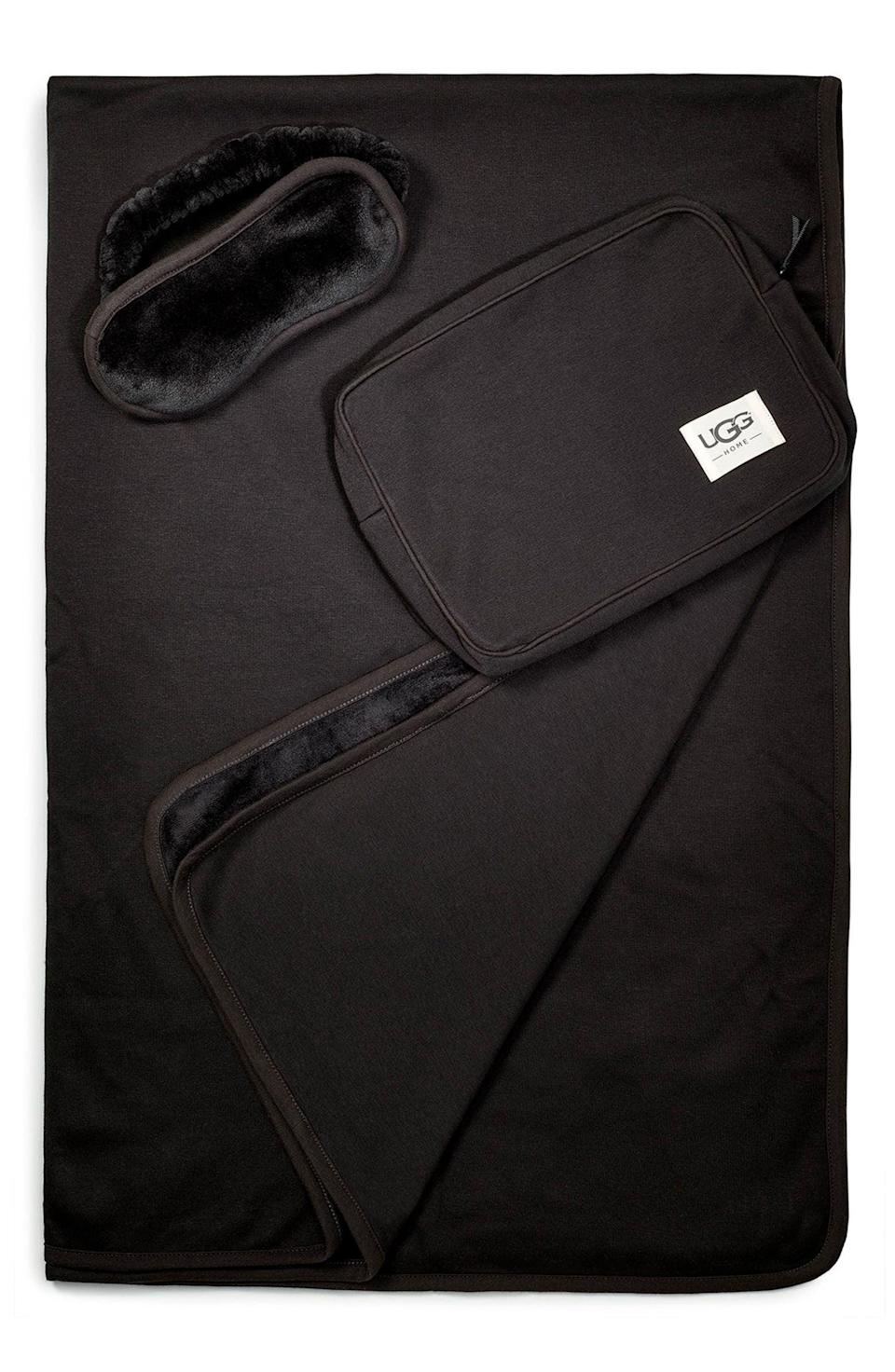 <p>If you're loved one travels a lot, get them this <span>Ugg Duffield Eye Mask, Pouch &amp; Blanket Travel Set</span> ($98). Not only will they actually use this set but they will endlessly thank you for it during those uncomfortable flights. The set contains a blanket, an eye mask, and a plush zip pouch that doubles as a pillow.</p>