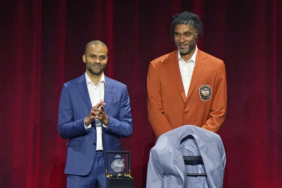 Tony Parker, left, applauds Tim Duncan, both former San Antonio Spurs, after presenting Duncan with his Hall of Fame jacket at the 2020 Basketball Hall of Fame awards tip-off celebration and awards gala Friday, May 14, 2021, in Uncasville, Conn. (AP Photo/Kathy Willens)