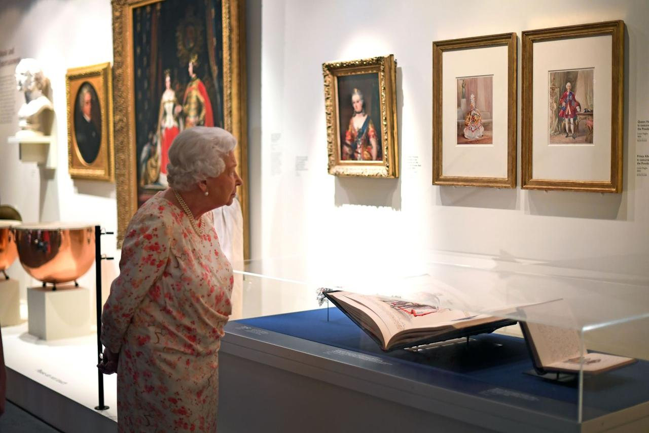 <p>Queen Elizabeth looks at portraits of Queen Victoria and Prince Albert by Louis Haghe, which are on display as part of the exhibit which marks the 200th anniversary of Victoria's birth.</p>