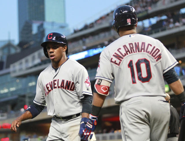 Cleveland Indians' Greg Allen is congratulated by Edwin Encarnacion (10) after scoring during the fifth inning of the team's baseball game against the Minnesota Twins on Tuesday, July 31, 2018, in Minneapolis. The Indians defeated the Twins 6-2. (AP Photo/Andy Clayton-King)