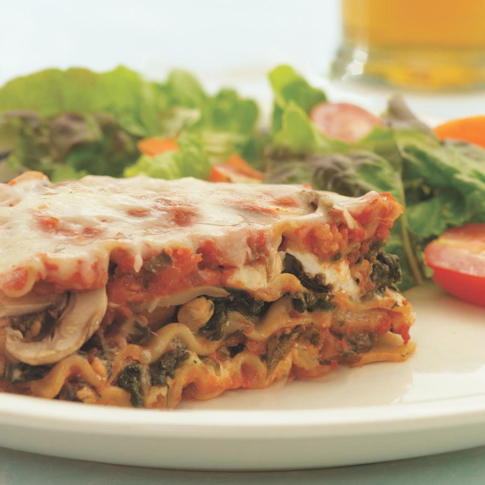 """<p>This cheesy lasagna is full of spicy Italian turkey sausage, whole-wheat noodles, mushrooms and spinach. A serving of this version has about one-third the fat and saturated fat, and only half the calories of the original. Use soy-based sausage for a hearty vegetarian variation. <a href=""""https://www.eatingwell.com/recipe/251754/sausage-mushroom-spinach-lasagna/"""" rel=""""nofollow noopener"""" target=""""_blank"""" data-ylk=""""slk:View Recipe"""" class=""""link rapid-noclick-resp"""">View Recipe</a></p>"""