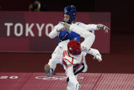 Iran's Nahid Kiyani, front, attacks Kimia Alizadeh, of the Refugee Olympic Team, during the women's 57kg match at the 2020 Summer Olympics, Sunday, July 25, 2021, in Tokyo, Japan. (AP Photo/Themba Hadebe)