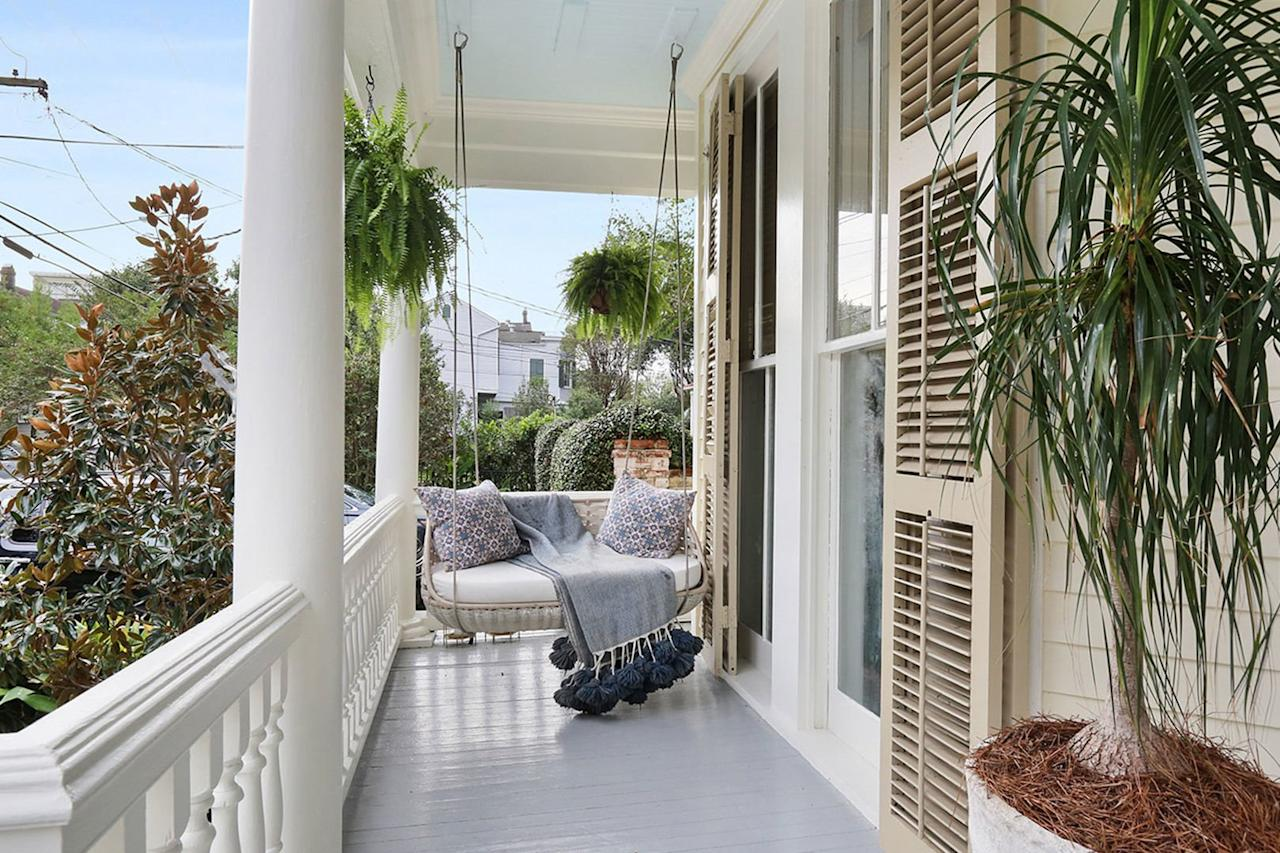 <p>Like any good front porch in the South, this one features haint blue on the ceiling and a cozy swing. </p>