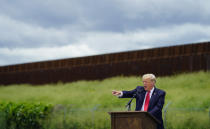 Former President Donald Trump speaks during a visit to an unfinished section of border wall with Texas Gov. Greg Abbott, in Pharr, Texas, Wednesday, June 30, 2021. (AP Photo/Eric Gay)