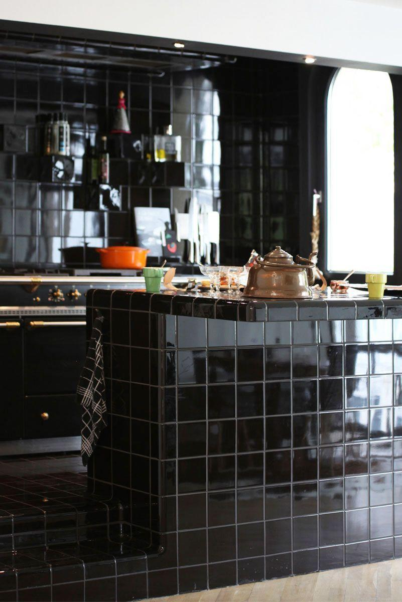 "<p>Designed by <a href=""https://studiohelder.be/"" rel=""nofollow noopener"" target=""_blank"" data-ylk=""slk:Studio Helder"" class=""link rapid-noclick-resp"">Studio Helder</a>, this striking kitchen is completely covered in glossy dTiles. It straddles a unique line between retro and futuristic. Plus, they're easy to clean. </p>"