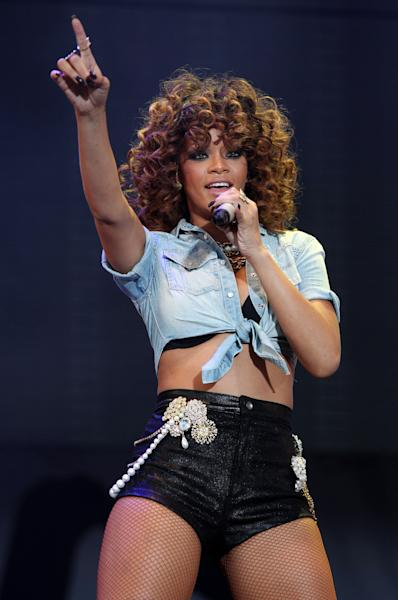 FILE - In this Aug. 21, 2011 file photo, singer Rihanna performs on stage at the V Music Festival in Hylands Park, Chelmsford, England. Rihanna's former boyfriend Chris Brown will perform at this year's Grammy Awards, the event where his career almost ended three years ago. Brown assaulted then-girlfriend Rihanna at a pre-Grammy party in 2009 and is serving five years of probation for the felony attack. Rihanna will also perform at the show. She's up for four awards. (AP Photo/Joel Ryan, file) EDITORIAL USE ONLY