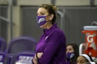 TCU head coach Raegan Pebley shouts instructions to her team in the second half of an NCAA college basketball game against Iowa State in Fort Worth, Texas, Wednesday, Dec. 2, 2020. (AP Photo/Tony Gutierrez)