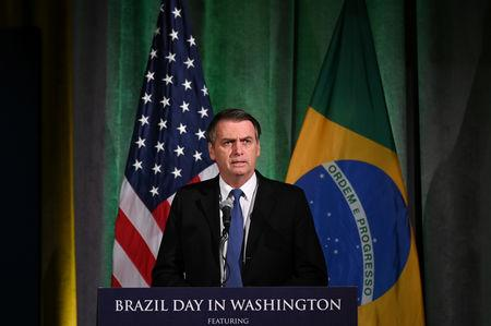 Brazilian President Jair Bolsonaro participates in a Brazil-U.S. Business Council forum to discuss relations and future cooperation and engagement  in Washington, U.S. March 18, 2019. REUTERS/Erin Scott