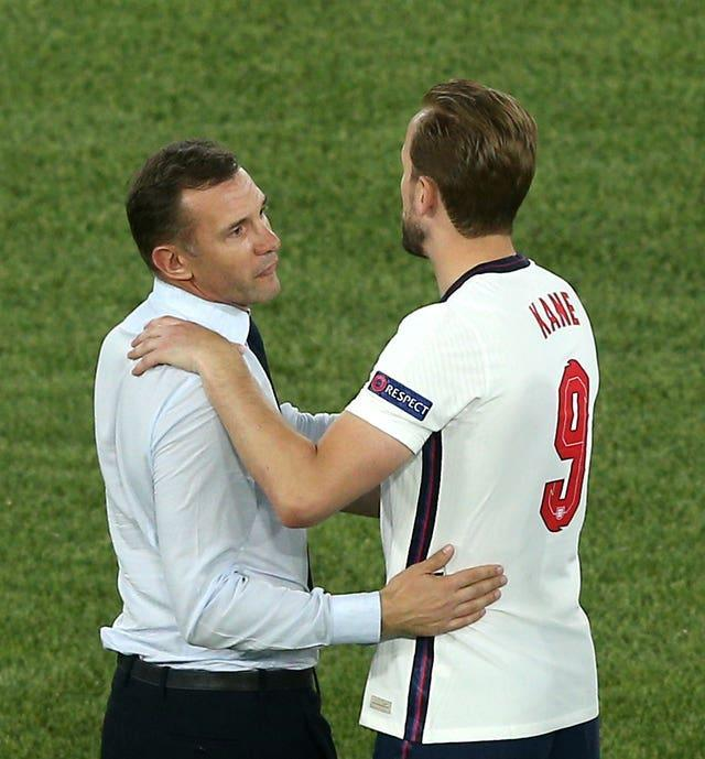 Harry Kane is congratulated by Andriy Shevchenko, left, after the final whistle