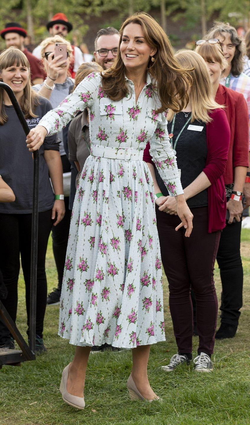 """<p>The Duchess of Cambridge attends the """"Back to Nature"""" festival in RHS Garden at Wisley in a dress by <a href=""""https://www.matchesfashion.com/womens/designers/emilia-wickstead"""" rel=""""nofollow noopener"""" target=""""_blank"""" data-ylk=""""slk:Emilia Wickstead"""" class=""""link rapid-noclick-resp"""">Emilia Wickstead</a>.</p>"""