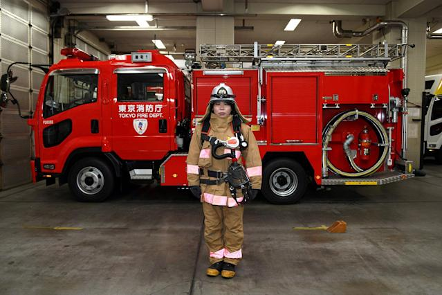 <p>Ran Namise, 24, a firefighter belonging to the command squad, poses in front of a fire engine at Kojimachi Fire Station in Tokyo on February 23, 2018. (Photo: Kazuhiro Nogi/AFP/Getty Images) </p>