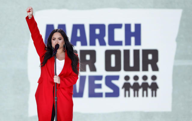 "<p>Singer Demi Lovato salutes the crowd after performing the song ""Skyscraper"" during the ""March for Our Lives"" event demanding gun control after recent school shootings at a rally in Washington, U.S., March 24, 2018. (Aaron P. Bernstein/Reuters) </p>"