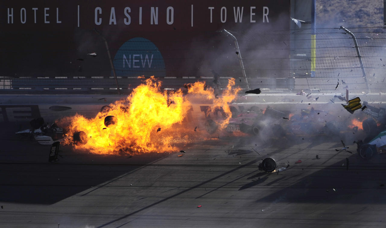 LAS VEGAS - OCTOBER 16:  The car of Dan Wheldon  driver of the #77 Bowers & Wilkins Sam Schmidt Motorsports Dallara Honda (top left) bursts into flames in a 15 car pile up during the Las Vegas Indy 300 part of the IZOD IndyCar World Championships presented by Honda on October 16, 2011 at the Las Vegas Motor Speedway in Las Vegas, Nevada.  (Photo by Robert Laberge/Getty Images)