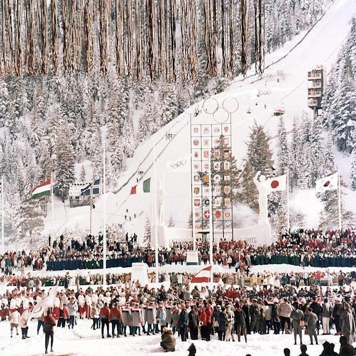 <p>Chairman Walt Disney was in charge of the pageantry of the opening and closing ceremonies; Vice President Richard Nixon opened the Games officially and speed skater Kenneth Henry lit the flame. The Olympic Hymn, composed by Spyridon Samaras with lyrics by poet Kostis Palamas for the 1896 Games, becomes the official anthem. </p>