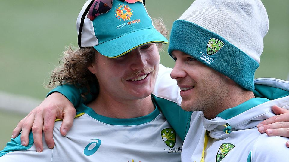 Australia's Will Pucovski and Tim Paine have a laugh at training ahead of the third Test at the SCG. (Photo by SAEED KHAN/AFP via Getty Images)