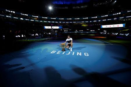 Tennis - China Open - Men's Singles - Final - National Tennis Center, Beijing, China - October 7, 2018. Nikoloz Basilashvili of Georgia poses with the trophy after winning the match against Juan Martin del Potro of Argentina. REUTERS/Jason Lee