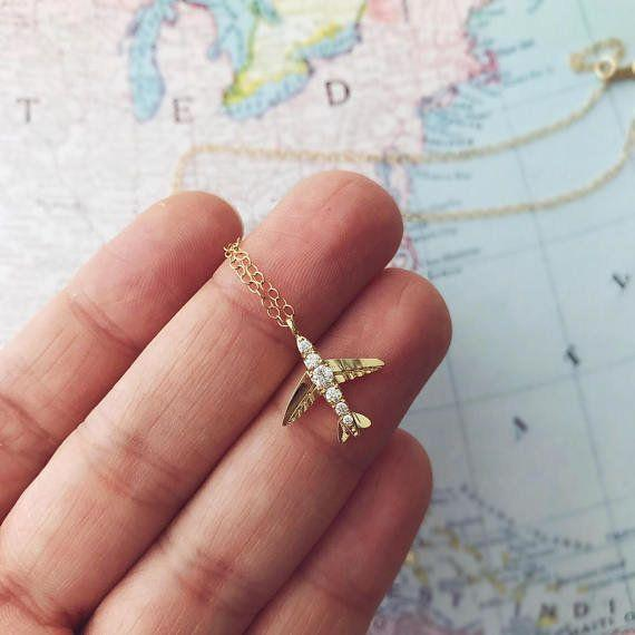 """For the traveler who has """"everywhere"""" on their travel list. <strong><a href=""""https://www.etsy.com/listing/254759461/wanderlust-necklace-travel-gift-airplane?ref=holiday-gift-guide"""" target=""""_blank"""" rel=""""noopener noreferrer"""">Get it here</a></strong>."""