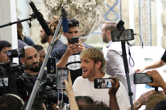 Logan Paul is interviewed during a media event.